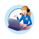 Person talking on headset in Hometown Ticketing Uniform while looking at laptop